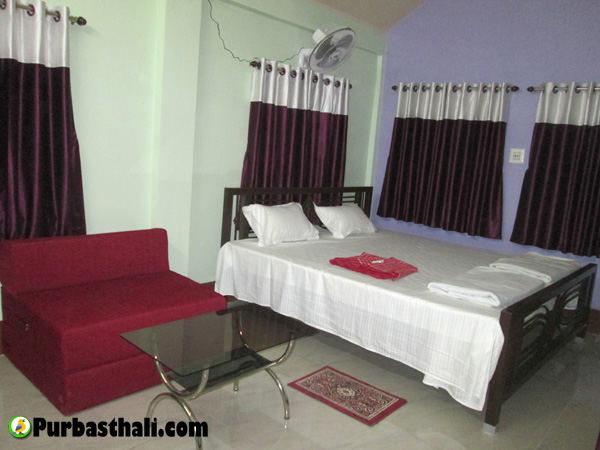 Purbasthali cottage room